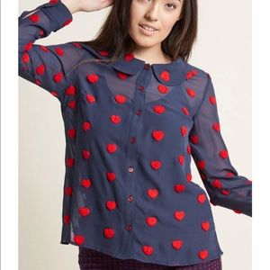 Blue blouse with fuzzy red hearts.